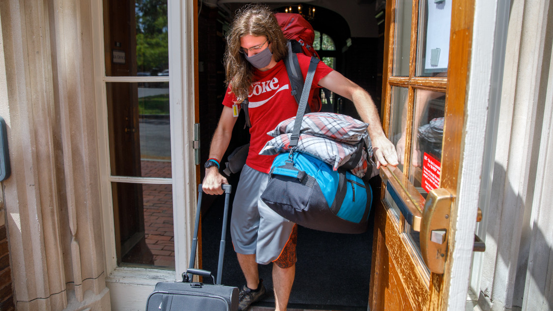 Wilhelm Albrecht, '21 CALS, arrives at Risley Hall from his home in Buffalo, NY to begin preparing for orientation training.